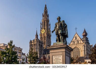 Statue of Peter Paul Rubens with the Cathedral of our Lady in the background, in Antwerp, Belgium.
