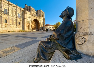 Statue of Pilgrim Looking at the Parador and San Marcos Church in León along the Way of St James Pilgrimage Trail Camino de Santiago