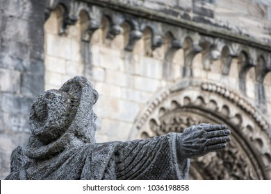 Statue of Pilgrim seen from behind and closely with a extentido arm in Portomarin Galicia Spain, on the Camino de Santiago
