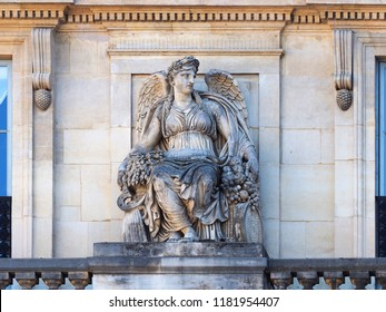 Statue positioned by balustrade of the Palais Royal (1767-1769). Palais Royal or Palais Cardinal was personal residence of Cardinal Richelieu in Paris. Located opposite the north wing of the Louvre