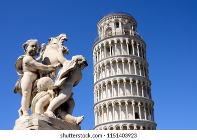 Statue of Putti Fountain (la fontana dei putti) in front of the leaning tower of Pisa