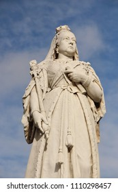 Statue of Queen Victoria in Port Louis, Mauritius. The inscription on the plinth reads: To the memory of our beloved and much regretted Queen Victoria. Empress of India. The inhabitants of Mauritius.