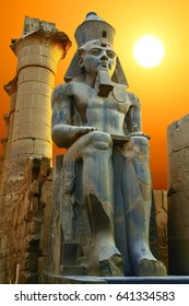 Statue of Ramesses II at sunset. Luxor Temple, Egypt