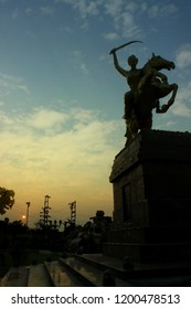 Statue of Rani Laxmibai of Jhansi on horse with a sunset at Jhansi city Uttar Pradesh, India.