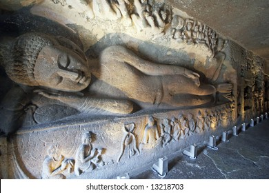 Statue of a reclining Buddha carved on the wall of the ancient Buddhist rock temple (Mahayan Chaitya-Griha Cave Temple), Ajanta Caves near Aurangabad, India. 5th-6th Century AD.