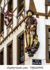 Statue representing Guillaume Tell, has the angle of the coffee of the same name and legendary hero of Swiss independence. FRANCE - Mulhouse October 2017