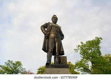 STATUE OF RIEGER, RIEGER GARDENS, PRAGUE, CZECH REPUBLIC / CZECHIA - APRIL 23, 2018: Bronze sculpture of Czech nationalist politician. Landmark, monuemnt and memorial in the park. Evening light
