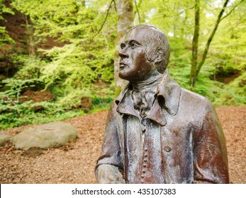 Statue of Robert Burns Scottish poet and lyricist at the Birks Of Aberfeldy, Scotland, UK