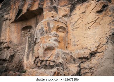 Statue rock carving in Longmen Grottoes at Yi River, Luoyang City, Henan province, China