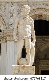 Statue of the Roman god of the sea - Neptune at the top of the Giants' Staircase to the historic Doge's Palace in Venice, Italy. Sculpted by the Renaissance artist Jacopo Sansovino.