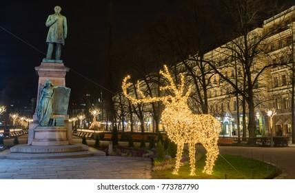 Statue of Runeberg by Christmas night in Park Esplanade, Helsinki Finland. 5th of December 2017.