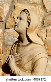 Statue of Saint Bernadette Kneeling before the Blessed Mother