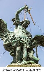 Statue of Saint Michael at the top of Sant Angelo castel in a summer day in Rome, Italy
