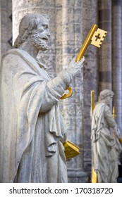 Statue of Saint Peter, the apostle that founded the (Catholic) Church, holding the keys to the church. Saint Michaels church, Ghent, Flanders, Belgium.
