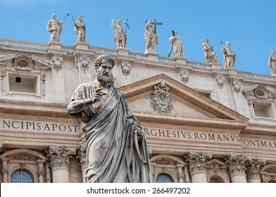 Statue of Saint Peter and Saint Peter's Basilica at background in St. Peter's Square, Vatican City, Rome, Italy