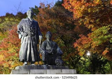 Statue of Sakamoto Ryoma & Nakaoka Shintaro at Maruyama Park with autumn color at dusk, Kyoto, Japan