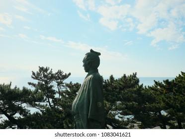 Statue of Sakamoto Ryoma stands on the hill near Katsurahama beach in Kochi, Japan