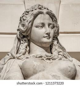 Statue of sensual busty and puffy renaissance era woman in Vienna, Austria