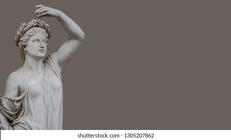Statue of sensual Roman Renaissance Era woman in circlet of bay leaves, isolated, Potsdam, Germany