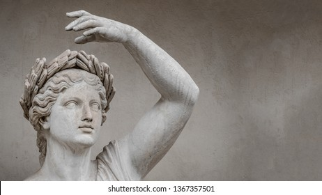 Statue of sensual Roman renaissance era woman in circlet of bay leaves, Potsdam, Germany