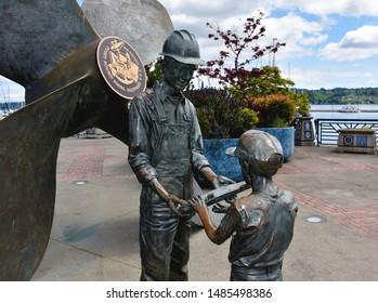 Statue with Shipyard worker, Puget Sound Naval Shipyard Memorial Plaza, Bremerton, WA, USA, May 11, 2018