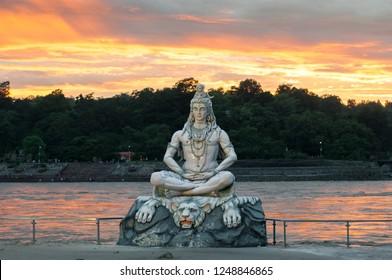 Statue of Shiva at sunset, on the Ganges, Rishikesh, India