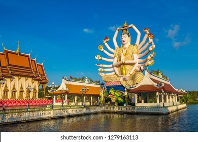 Statue of Shiva in Wat Plai Laem Temple, Samui, Thailand in a summer day
