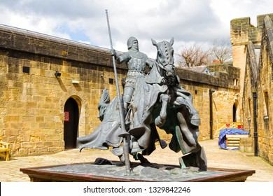 The statue of Sir Henry Percy or Sir Harry Hotspur, a late-medieval English nobleman, the 6th Earl of Nothumberland displayed at Alnwick Castle, UK
