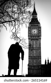 Statue of Sir Winston Churchill is in front of the Big Ben looking towards the tower clock.