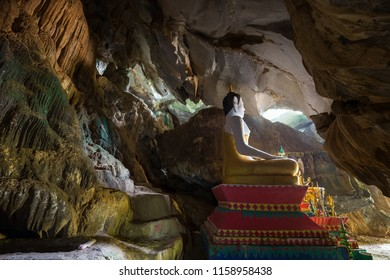 Statue of a sitting Buddha inside the Tham Hoi Cave near Vang Vieng, Vientiane Province, Laos.
