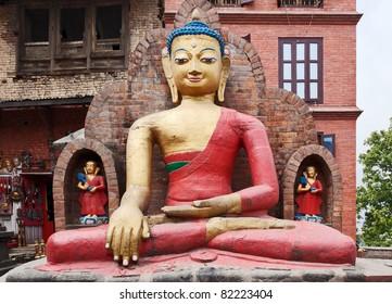a statue of sitting Buddha in Swayambhunath - Kathmandu, Nepal