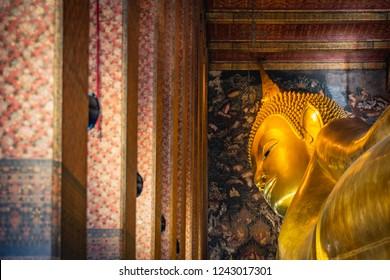 Statue of Sleep Buddha or Reclining Buddha in Wat Pho Temple in Bangkok, Thailand