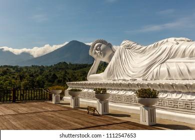 Statue of Sleeping Buddha at Vihara Dharma Giri, Buddhist temple in the village of Pupuan in Tabanan, West Bali, Indonesia