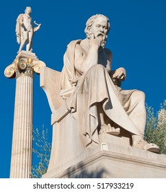 The statue of Socrates, statue of Apollo in the background. Athens, Greece.