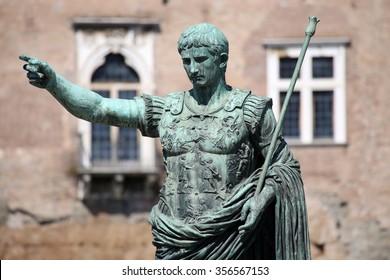 Statue S.P.Q.R. IMP CAESAR Augustus PATRIAE PATER on street Via dei Fori Imperiali, Rome, Italy