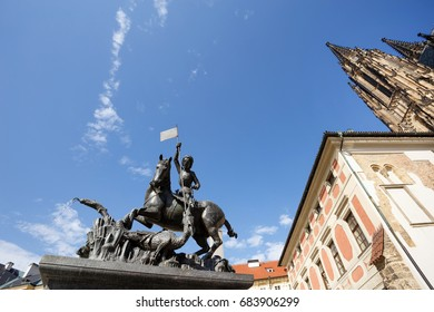 Statue of St. George and a fountain - Prague Castle. St. Vitus Cathedral in Prague, Czech Republic
