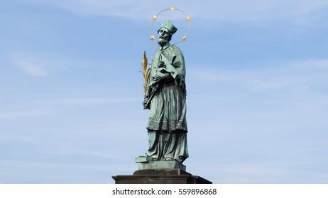 Statue of St. John of Nepomuk on the Charles Bridge in Prague, Czech Republic