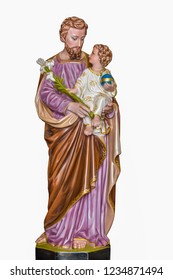 Statue of St. Joseph And the young Jesus, Sculpture of St. Joseph and Jesus  inside a catholic church.