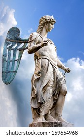 The statue of the St. Michael sculpted by Raffaello Da Montelupo. It stands in Castel Sant'Angelo - Rome. The background was replaced with a blue sky.