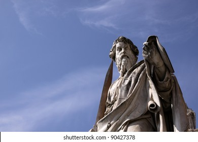 A statue of St. Paul backed by blue sky, Vatican City, Rome.