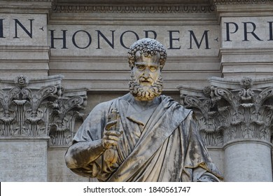 Statue of St. Peter with the keys of heaven in front of St. Peter's basilica in Rome. The Saint was the first pope of Christianity.