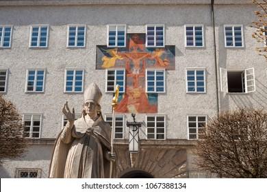 Statue of St. Rupert, patron saint of Salzburg, and fresco Gnadenstuhl der Dreifaltigkeit (Mercy seat of Trinity) by Anton Faistauer (1926), St.Benedict college in St. Peter's Abbey, Salzburg, Austria