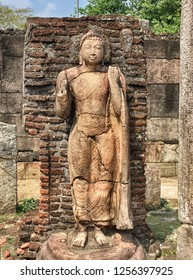 A statue of a stone gurdian stands within Hatadage or the Shrine of Sixty Relics in the ancient city of Polonnaruwa in Sri Lanka.