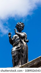 Statue of the Terpsichore - the muse of dance. Roof of the Clarendon building, Oxford University. The statue is by James Thornhill, dating from the early 18th century.