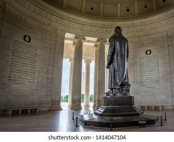 Statue of Thomas Jefferson from the rear looking at the Washington memorial, in the Jefferson Monument in Washington DC, USA on 13 May 2019