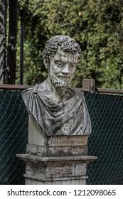 Statue of Tito Lucrezio Caro in the villa Borghese gardens
