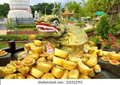 Statue and traditional chinese ancient gold bullion nugget.