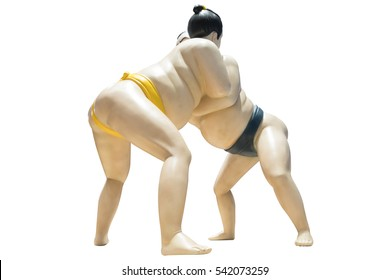 statue of two Japanese sumo wrestler wrestling isolated on white background with clipping path