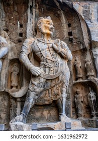 Statue of Vajrapani in the main cave (Fengxiangsi Cave) of Longmen Grottoes in Luoyang, . A major Buddhist caves of China, a world heritage Site in Henan, China.