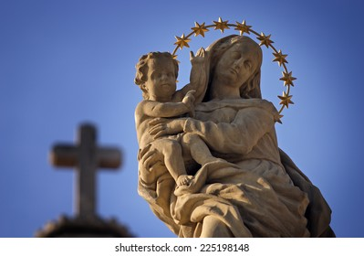 Statue of Virgin Mary and Jesus from the cross sky background